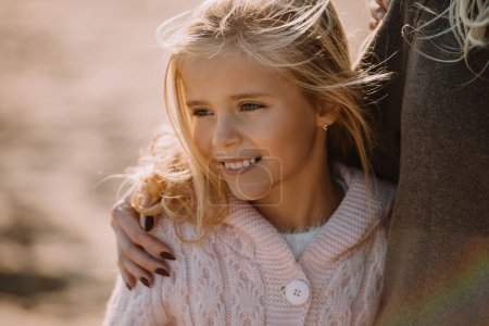 Photo for Cropped view of mother hugging her smiling daughter - Royalty Free Image