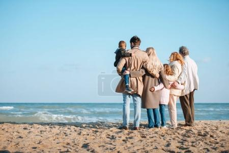 family spending time at seaside