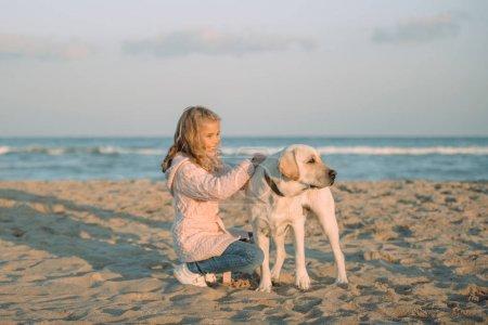 kid walking with dog