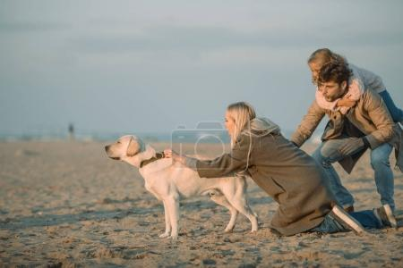 family with labrador dog