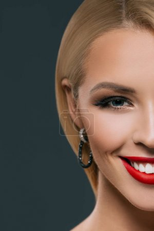 Photo for Cropped view of beautiful smiling woman with makeup, isolated on grey - Royalty Free Image