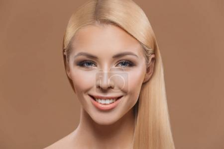 Photo for Portrait of beautiful blonde long hair girl isolated on beige - Royalty Free Image