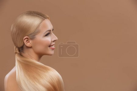 Photo for Smiling beautiful blonde hair girl isolated on beige - Royalty Free Image
