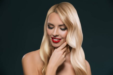 portrait of beautiful blonde hair girl with makeup isolated on black