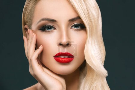 Photo for Portrait of attractive blonde woman with perfect skin, isolated on grey - Royalty Free Image