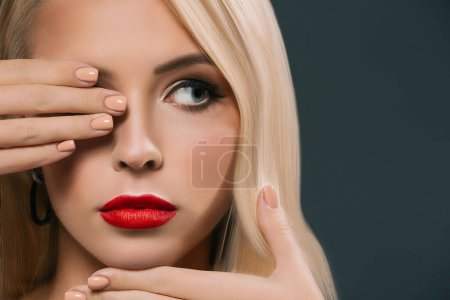 Photo for Beautiful woman closing eye, isolated on grey - Royalty Free Image