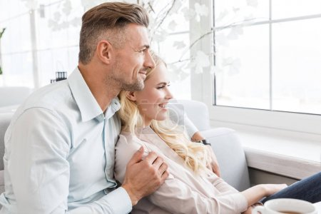 Photo for Couple spending time together and looking through window - Royalty Free Image