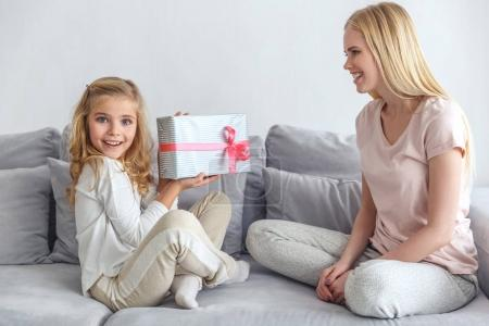 Photo for Daughter holding birthday gift made by mother - Royalty Free Image