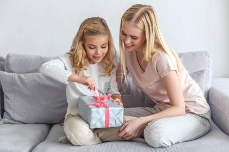 Photo for Daughter opening birthday gift made by mother - Royalty Free Image