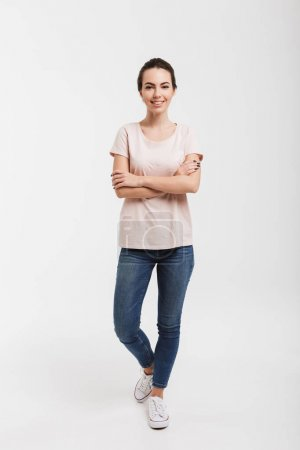 smiling girl standing with crossed arms isolated on white
