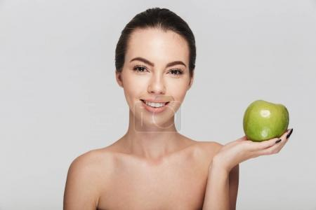 Photo for Attractive young woman with fresh green apple isolated on white - Royalty Free Image