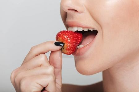 Photo for Cropped shot of woman eating strawberry isolated on white - Royalty Free Image