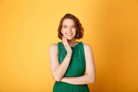 Photo for Portrait of pretty smiling woman looking at camera isolated on orange - Royalty Free Image
