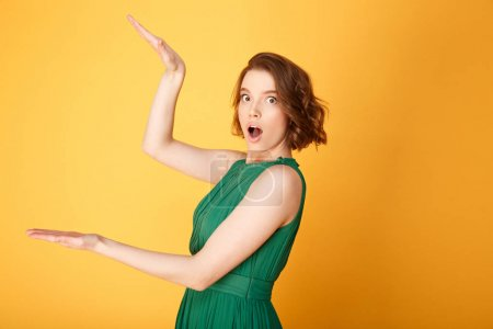 Photo for Portrait of young shocked woman gesturing isolated on orange - Royalty Free Image