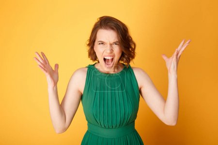 Photo for Portrait of screaming angry woman isolated on orange - Royalty Free Image