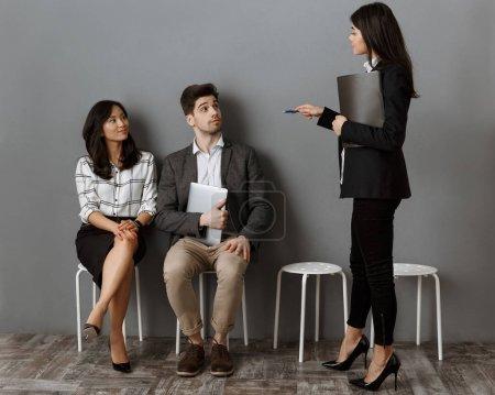 businesswoman with folder choosing colleague for job interview