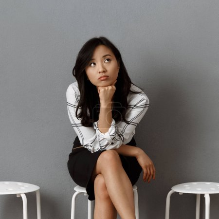 Photo for Pensive asian businesswoman waiting for job interview - Royalty Free Image