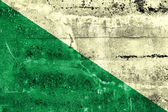 Flag of Huanuco, Peru, painted on dirty wall