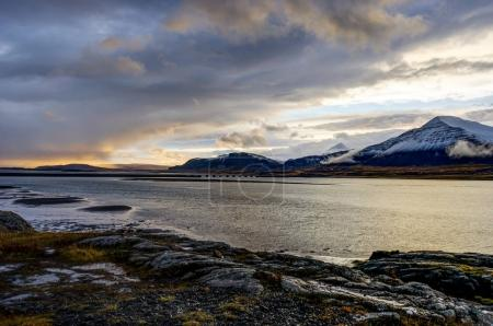 Atlantic Ocean with snow capped mountains and Icelandic Landscap