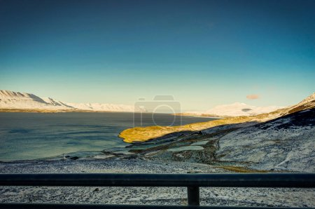 Iceland Winter view across Atlantic Ocean towards Snow Capped Mo