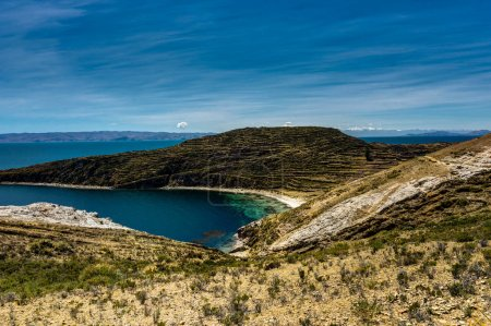 View across La isla del Sol with blue Sky water and trees Lake T