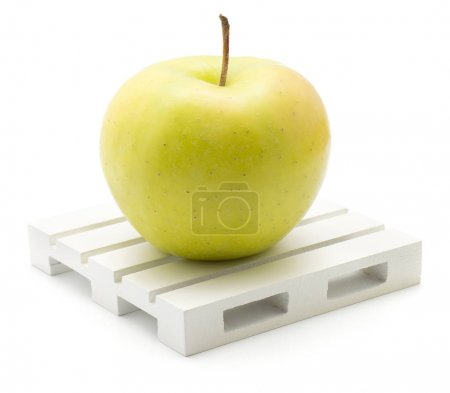 Apple (Smeralda variety) on a pallet isolated on white background one green yellow with blus