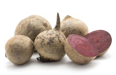 Beetroot (raw red beet) set isolated on white background four bulbs and one cut in hal