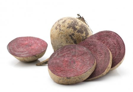 Beetroot (raw red beet) one bulb and four sliced rings isolated on white backgroun