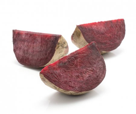 Three beetroot slices (raw red beet) isolated on white backgroun
