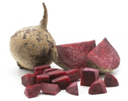 Beetroot (raw red beet) isolated on white background one bulb two slices and chopped pieces se