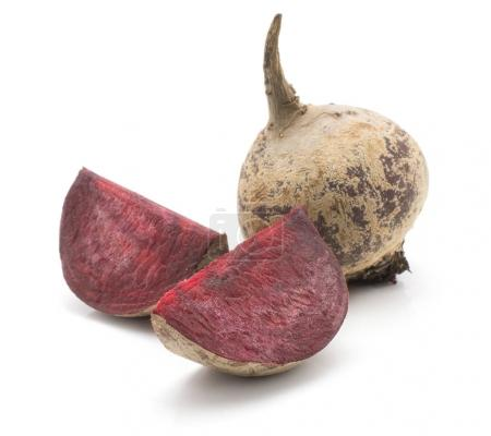 One beetroot bulb and two slices (raw red beet) isolated on white backgroun