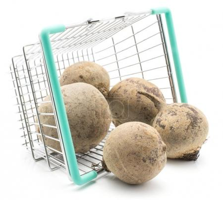 Beetroot (red beet) out a shopping basket isolated on white backgroun