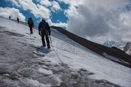 People hiking in snowy mountains