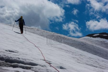 Person hiking in snowy mountains
