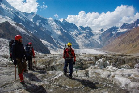 Photo for People hiking in snowy mountains, scenic landscape, Russia, Caucasus - Royalty Free Image