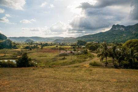 Photo for Beautiful scenic landscape with mountains, palms and cloudy sky, Cuba, Vinales Valley, november 2016 - Royalty Free Image