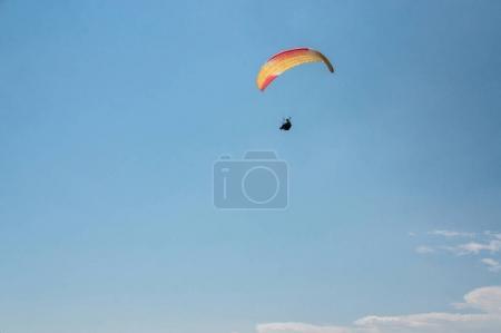 man flying on paraglider
