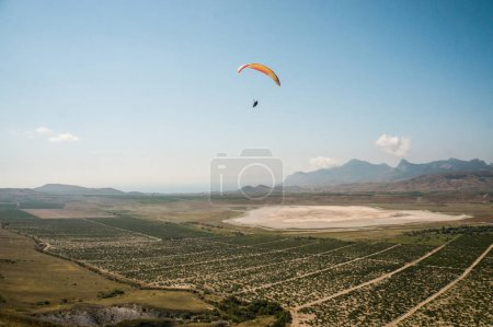 Person flying on paraglider