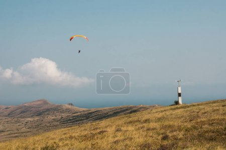 Person flying on paraplane