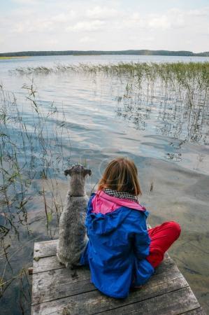 girl and dog at lake