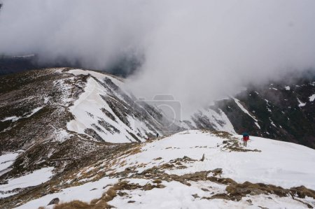 Photo for Person hiking in snowy mountains, scenic landscape, Ukraine, Carpathians, may 2016 - Royalty Free Image
