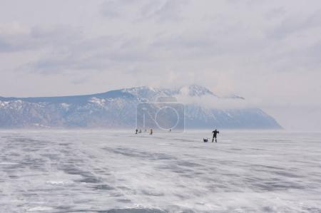 People on frozen river