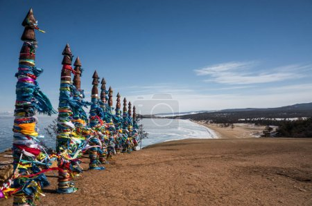 wooden pillars with colorful ribbons