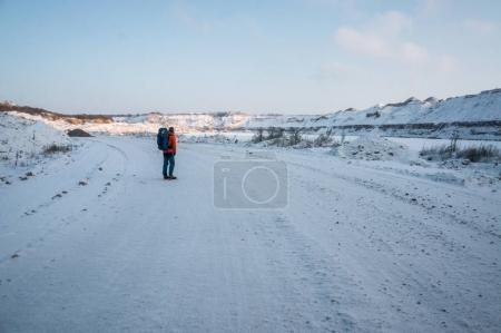 tourist standing on snowy road
