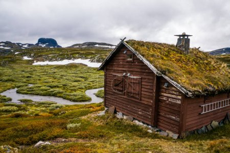 Photo for Beautiful landscape with little house on meadow with mountains and river, Norway, Hardangervidda National Park, september 2015 - Royalty Free Image