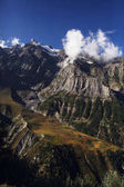 scenic landscape with rocky mountains and clouds in indian himalayas, keylong region