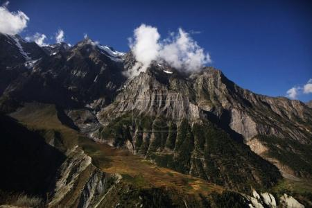 majestic landscape with rocky mountains and clouds in indian himalayas, keylong region