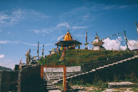traditional architecture and colorful prayer flags in Indian Himalayas, Rohtang Pass