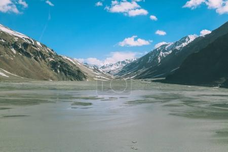 beautiful mountain valley with lake and snow capped peaks on Indian Himalayas, Ladakh region