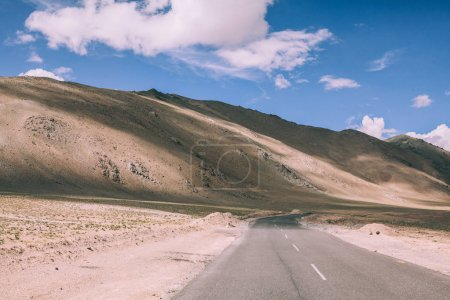 empty asphalt road in mountain valley in Indian Himalayas
